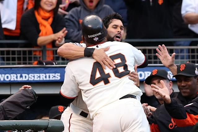 SAN FRANCISCO, CA - OCTOBER 24: Pablo Sandoval #48 of the San Francisco Giants celebrates with his teammate Angel Pagan #16 in the dugout after hitting a solo home run to center field against Justin Verlander #35 of the Detroit Tigers in first inning during Game One of the Major League Baseball World Series at AT&T Park on October 24, 2012 in San Francisco, California. (Photo by Christian Petersen/Getty Images)