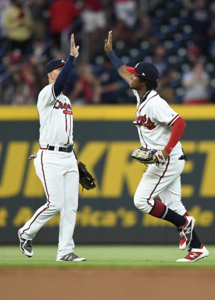 Atlanta Braves outfielders Rafael Ortega and Ronald Acuna Jr., right, celebrate after the team's baseball game against the Miami Marlins, Tuesday, Aug. 20, 2019, in Atlanta. The Braves won 5-1. (AP Photo/John Amis)