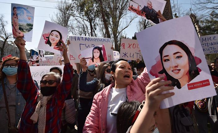 """<span class=""""caption"""">A protest against bride kidnapping in Kyrgyzstan's capital, Bishkek, on April 8, 2021, after a young woman abducted for marriage was found dead. </span> <span class=""""attribution""""><a class=""""link rapid-noclick-resp"""" href=""""https://www.gettyimages.com/detail/news-photo/people-hold-pictures-as-they-attend-a-rally-for-womens-news-photo/1232176999?adppopup=true"""" rel=""""nofollow noopener"""" target=""""_blank"""" data-ylk=""""slk:Vyacheslav Oseledko/AFP via Getty Images""""> Vyacheslav Oseledko/AFP via Getty Images</a></span>"""