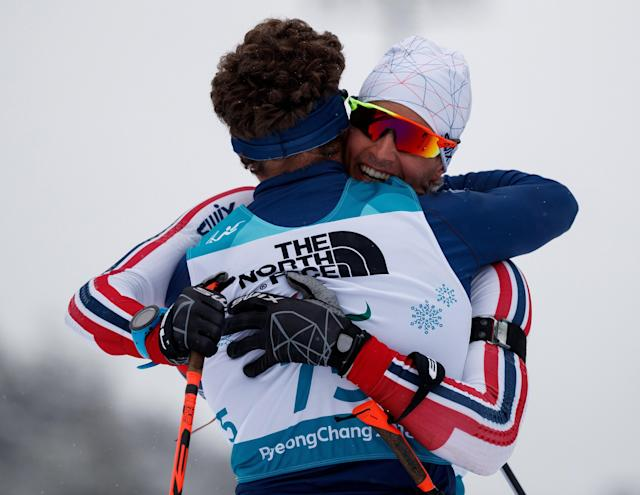 Silver Medalist Benjamin Daviet of France (L) congratulates Bronze Medalist Nils-Erik Ulset of Norway after finishing in the Biathlon Standing Men's 15km at the Alpensia Biathlon Centre. The Paralympic Winter Games, PyeongChang, South Korea, Friday 16th March 2018. OIS/IOC/Simon Bruty/Handout via Reuters