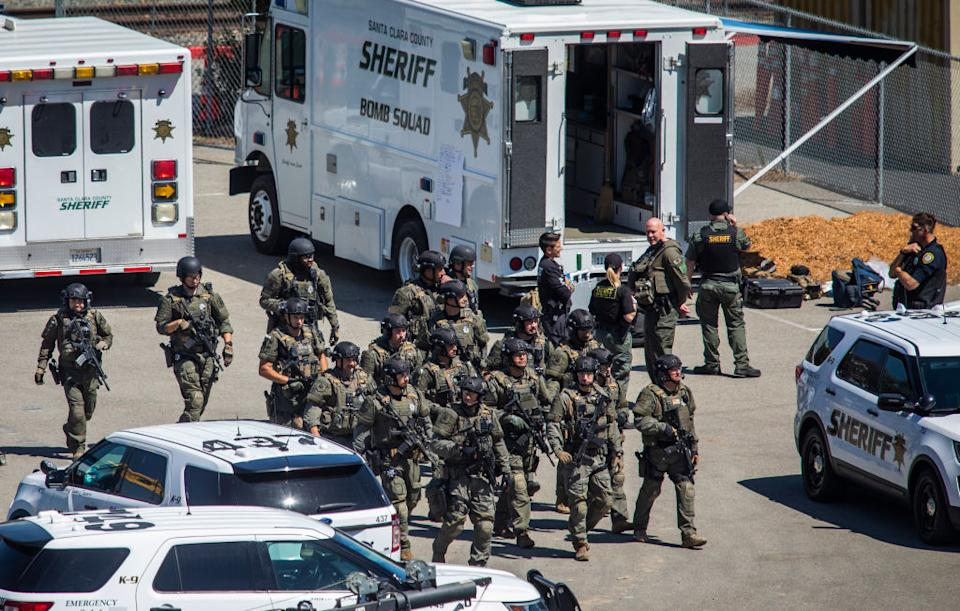 Tactical law enforcement officers move through the Valley Transportation Authority (VTA) light-rail yard where a mass shooting occurred in San Jose, California.