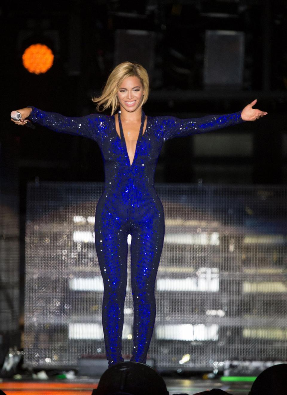 <p>Sparkly jumpsuits are nothing new. Queen Bey rocked one during a performance in England in 2013. (Photo: Samir Hussein/WireImage) </p>
