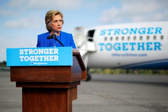 Hillary Clinton holds a news conference on the airport tarmac in front of her campaign plane. (Photo: Brian Snyder/Reuters)