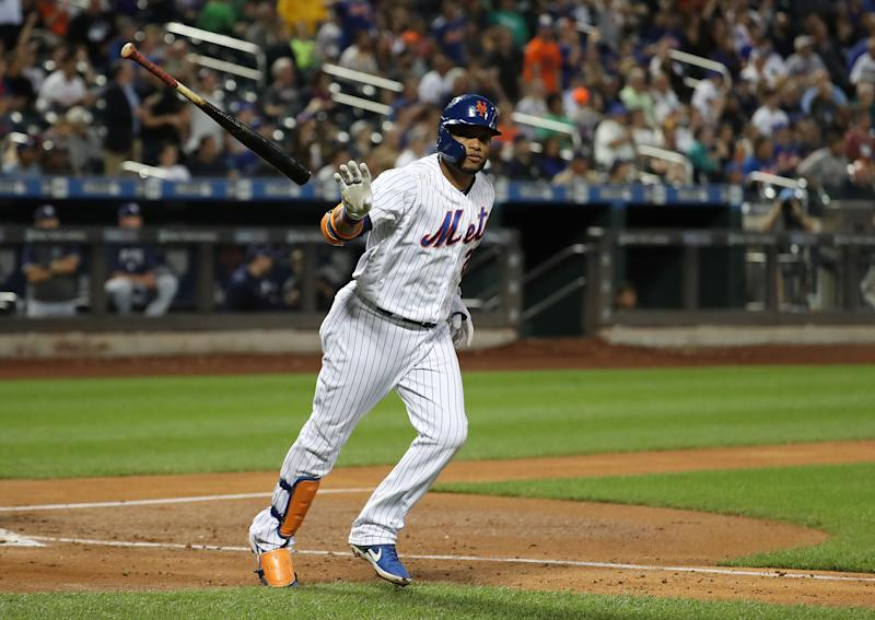 NEW YORK, NEW YORK - JULY 23: Robinson Cano #24 of the New York Mets hits a fourth inning home run against the San Diego Padres during their game at Citi Field on July 23, 2019 in New York City. (Photo by Al Bello/Getty Images)
