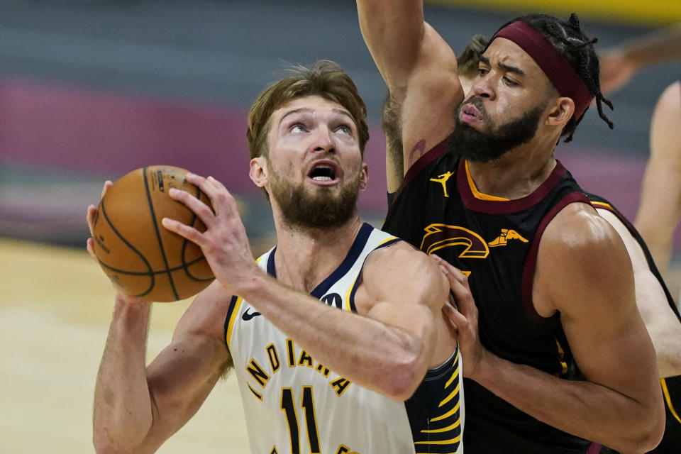 Indiana Pacers' Domantas Sabonis (11) looks to shoot against Cleveland Cavaliers' JaVale McGee during the second half of an NBA basketball game Wednesday, March 3, 2021, in Cleveland. (AP Photo/Tony Dejak)