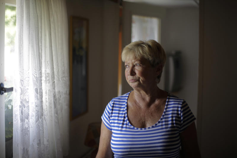 In this Aug. 29, 2013 photo, 70-year-old Christel Paweski, who worked in a hospital and a nursing home before retiring six years ago, looks out a window during an interview with The Associated Press in Berlin. Paweski's plight and that of millions of other Germans living below or close to the poverty line burst onto the campaign for the Sept. 22 national election after she tearfully confronted Chancellor Angela Merkel on national television, asking whether the country's leader had forgotten the growing numbers of retirees and working poor who have missed out on Germany's economic success. (AP Photo/Markus Schreiber)