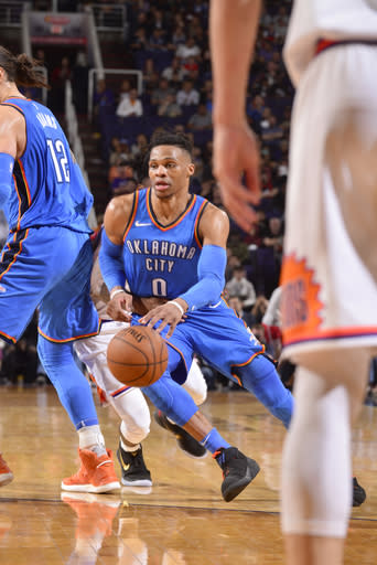 PHOENIX, AZ - MARCH 2: Russell Westbrook #0 of the Oklahoma City Thunder handles the ball against the Phoenix Suns on March 2, 2018 at Talking Stick Resort Arena in Phoenix, Arizona. (Photo by Barry Gossage/NBAE via Getty Images)