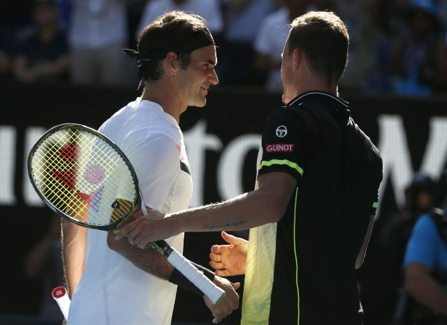 Tennis - Australian Open - Rod Laver Arena, Melbourne, Australia, January 22, 2018. Roger Federer of Switzerland shakes hands with Marton Fucsovics of Hungary after Federer won their match. REUTERS/Thomas Peter