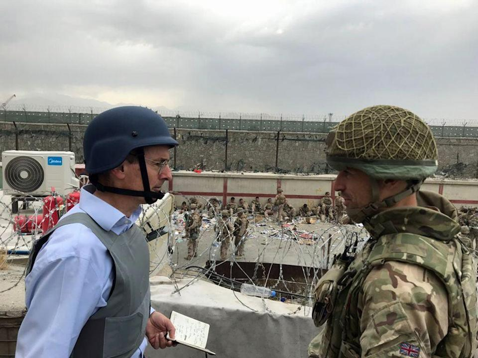 Sir Laurie Bristow, left, on the ground at Kabul airpot (FCO/PA) (PA Media)
