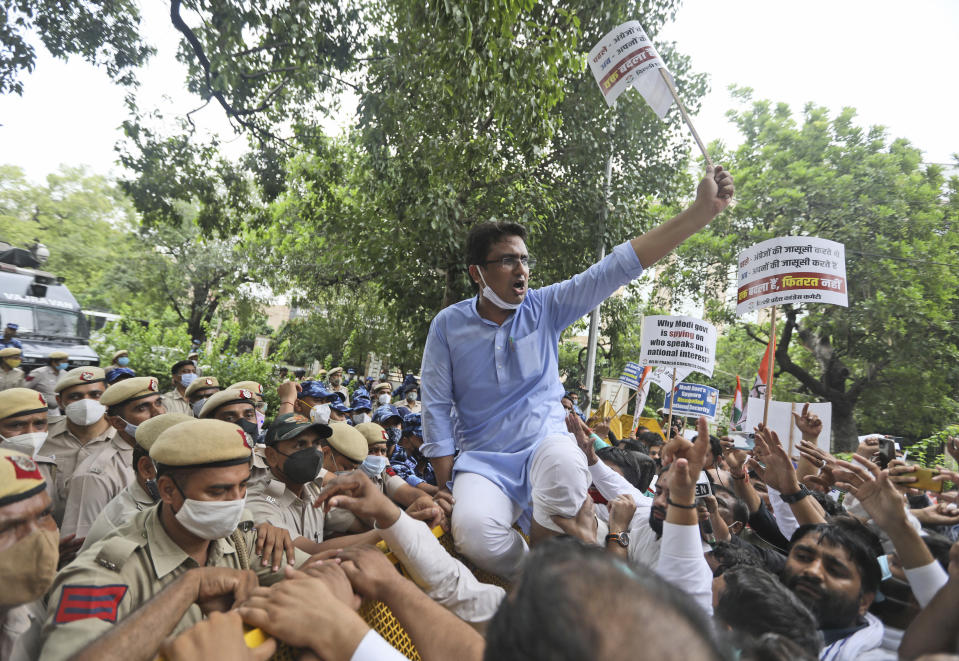 Congress party workers shout slogans during a protest accusing Prime Minister Narendra Modi's government of using military-grade spyware to monitor political opponents, journalists and activists in New Delhi, India, Tuesday, July 20, 2021. The protests came after an investigation by a global media consortium was published on Sunday. Based on leaked targeting data, the findings provided evidence that the spyware from Israel-based NSO Group, the world's most infamous hacker-for-hire company, was used to allegedly infiltrate devices belonging to a range of targets, including journalists, activists and political opponents in 50 countries. (AP Photo/Manish Swarup)