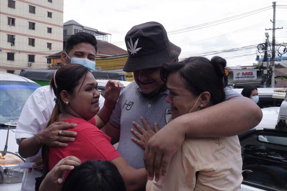 A man is embraced by two women outside Insein prison in Yangon, Myanmar Saturday, April 17, 2021. Myanmar's junta on Saturday announced it pardoned and released more than 23,000 prisoners to mark the new year holiday, but it wasn't immediately clear if they included pro-democracy activists who were detained in the wake of the February coup. (AP Photo)