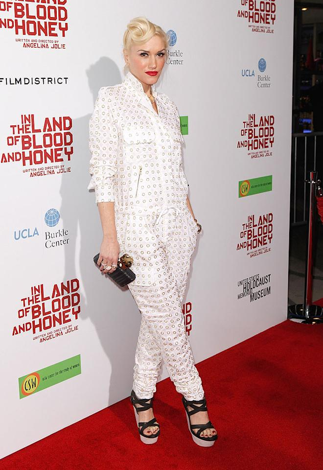 "Angelina Jolie's new BFF, Gwen Stefani, looked prepared to paint a barn -- not attend the glamorous premiere of Angie's directorial debut, ""In the Land of Blood and Honey"" -- thanks to her rumpled white jumpsuit. (12/8/2011)"