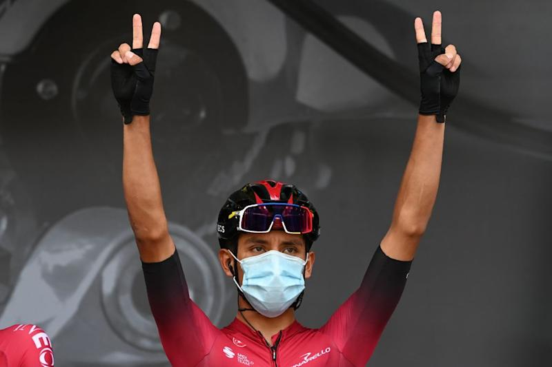 Team Ineos rider Colombias Egan Bernal wears a face protective mask as he flashes the V for victory prior to the first stage of the 72nd edition of the Criterium du Dauphine cycling race 2185 km between ClermontFerrand and SaintChristoenJarez on August 12 2020 Photo by AnneChristine POUJOULAT AFP Photo by ANNECHRISTINE POUJOULATAFP via Getty Images