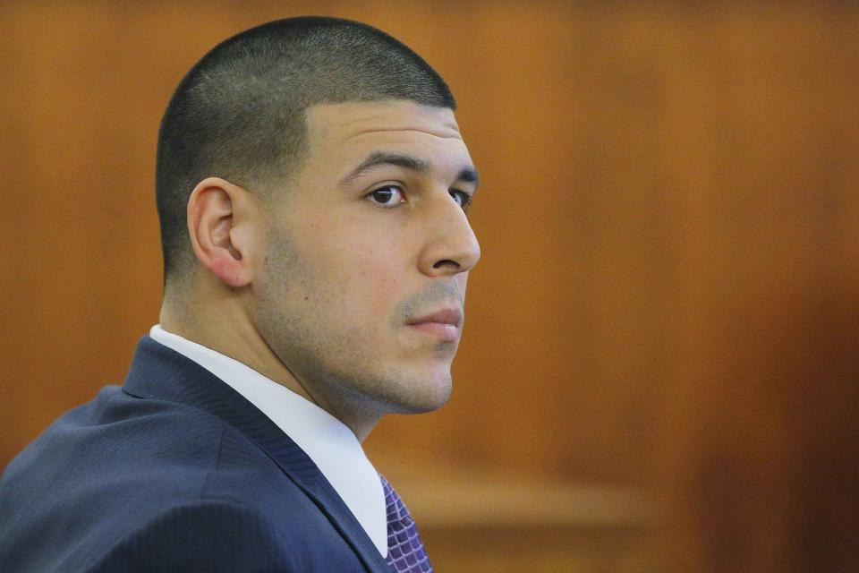 Former New England Patriots player Aaron Hernandez listens to testimony, during his murder trial at Bristol County Superior Court in Fall River, Massachusetts, February 24, 2015. Hernandez is accused of the murder of Odin Lloyd in June 2013. REUTERS/Brian Snyder (UNITED STATES - Tags: CRIME LAW SPORT FOOTBALL)