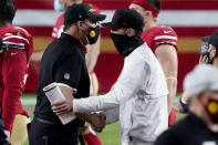 Washington Football Team head coach Ron Rivera, left, greets San Francisco 49ers head coach Kyle Shanahan after an NFL football game, Sunday, Dec. 13, 2020, in Glendale, Ariz. Washington won 23-15. (AP Photo/Rick Scuteri)