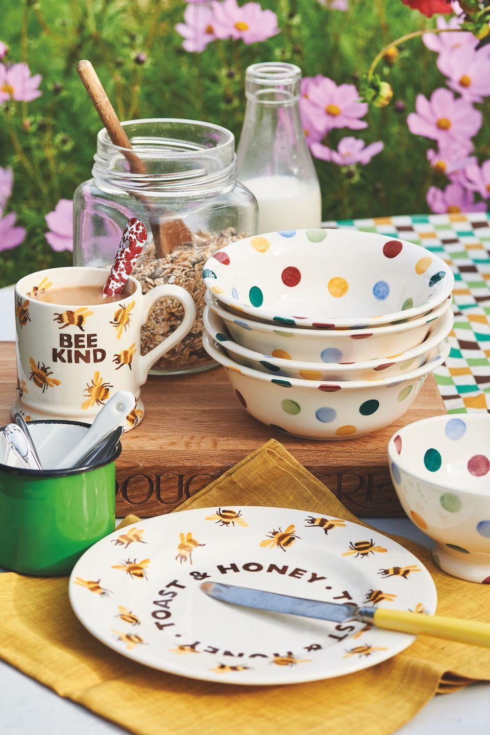 """<p>Whether your go-to breakfast is toast or cereal, Emma Bridgewater's new collection has everything you could possibly need. You'll find bowls, plates, butter knives, mugs and much more. </p><p><a class=""""link rapid-noclick-resp"""" href=""""https://go.redirectingat.com?id=127X1599956&url=https%3A%2F%2Fwww.emmabridgewater.co.uk%2Fcollections%2Fnew&sref=https%3A%2F%2Fwww.countryliving.com%2Fuk%2Fhomes-interiors%2Finteriors%2Fg35249240%2Femma-bridgewater-spring%2F"""" rel=""""nofollow noopener"""" target=""""_blank"""" data-ylk=""""slk:BUY NOW"""">BUY NOW</a></p>"""