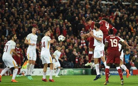 Firmino beats Fazio to score Liverpool's fifth - Credit: OLI SCARFF/AFP/Getty Images