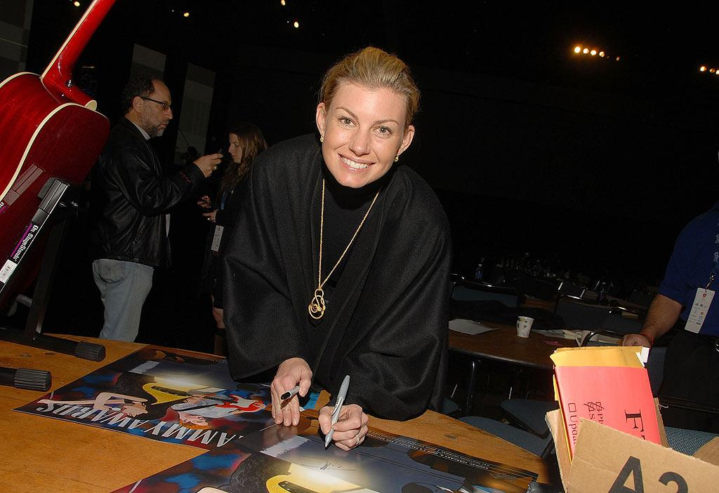 """This Kiss"" songstress Faith Hill signs a stack of auction items. Mark Sullivan/<a href=""http://www.wireimage.com"" target=""new"">WireImage.com</a> - February 5, 2009"