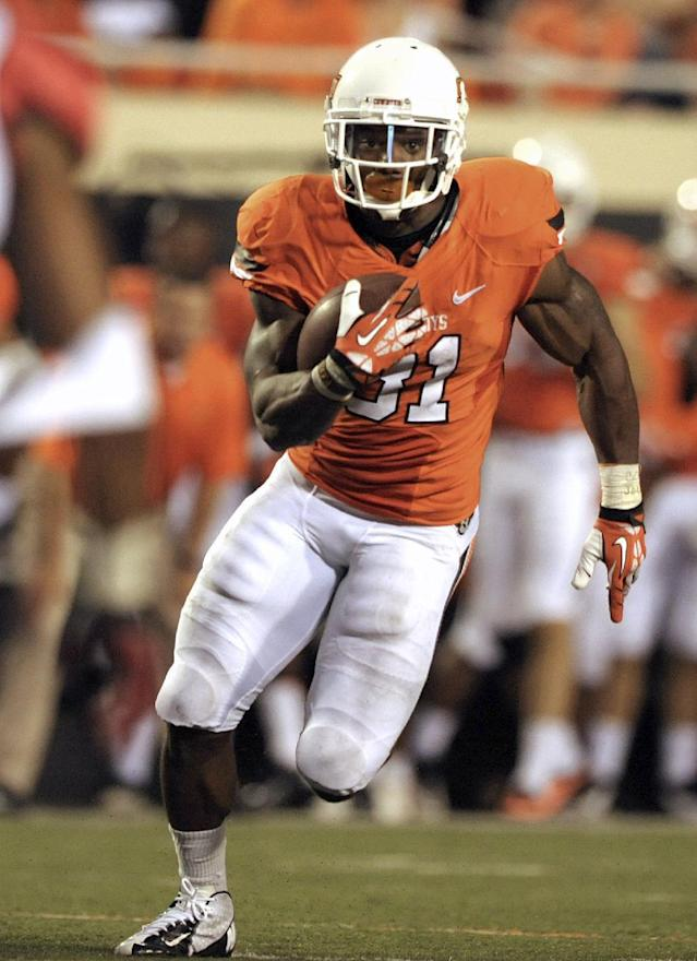 FILE - In this Sept. 14, 2013, Oklahoma State running back Jeremy Smith runs down field during an NCAA football game against Lamar in Stillwater, Okla. Smith has gone relatively unnoticed, though he shares the Big 12 lead in touchdowns. The Cowboys open conference play this weekend at West Virginia. (AP Photo/Brody Schmidt, File)