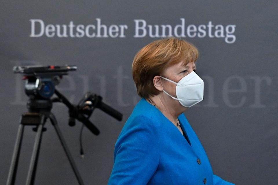 "German Chancellor Angela Merkel leaves after testifying in front of a parliamentary committee of inquiry investigating the financial scandal over payment systems provider Wirecard in Berlin, on April 23, 2021. - Chancellor Angela Merkel denied on April 23 that her government accorded ""special treatment"" to disgraced payments firm Wirecard, as she was grilled by MPs at a German parliamentary inquiry into the company's dramatic collapse. Merkel had been called to testify before lawmakers investigating the fraud scandal because of reports that she promoted the company during a trip to China in September 2019, when journalists were already voicing doubt about Wirecard's books. (Photo by John MACDOUGALL / AFP) (Photo by JOHN MACDOUGALL/AFP via Getty Images) (Photo: JOHN MACDOUGALL via Getty Images)"