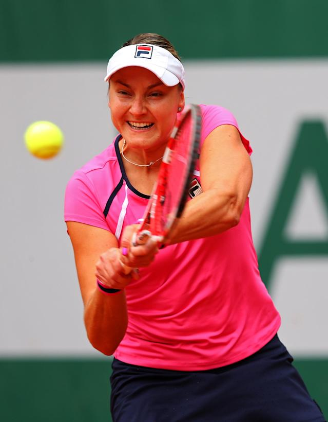 PARIS, FRANCE - MAY 26: Nadia Petrova of Russia plays a backhand during her women's singles match against Monica Puig of Puerto Rico during day one of the French Open at Roland Garros on May 26, 2013 in Paris, France. (Photo by Julian Finney/Getty Images)