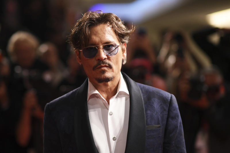 Actor Johnny Depp poses for photographers upon arrival at the premiere of the film 'Waiting for the Barbarians' at the 76th edition of the Venice Film Festival, Venice, Italy, Friday, Sept. 6, 2019. (Photo by Arthur Mola/Invision/AP)