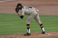 San Diego Padres starting pitcher Chris Paddack reads the signs while pitching against the Los Angeles Dodgers during the first inning of a baseball game, Thursday, Aug. 13, 2020, in Los Angeles. (AP Photo/Jae C. Hong)