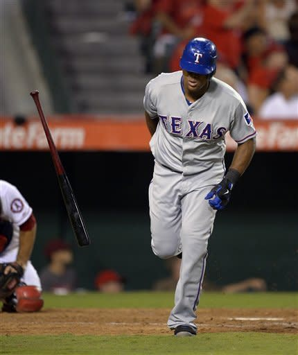 Texas Rangers' Adrian Beltre drops his bat as he hits a two-run home run during the ninth inning of their baseball game against the Los Angeles Angels, Thursday, Sept. 20, 2012, in Anaheim, Calif. (AP Photo/Mark J. Terrill)