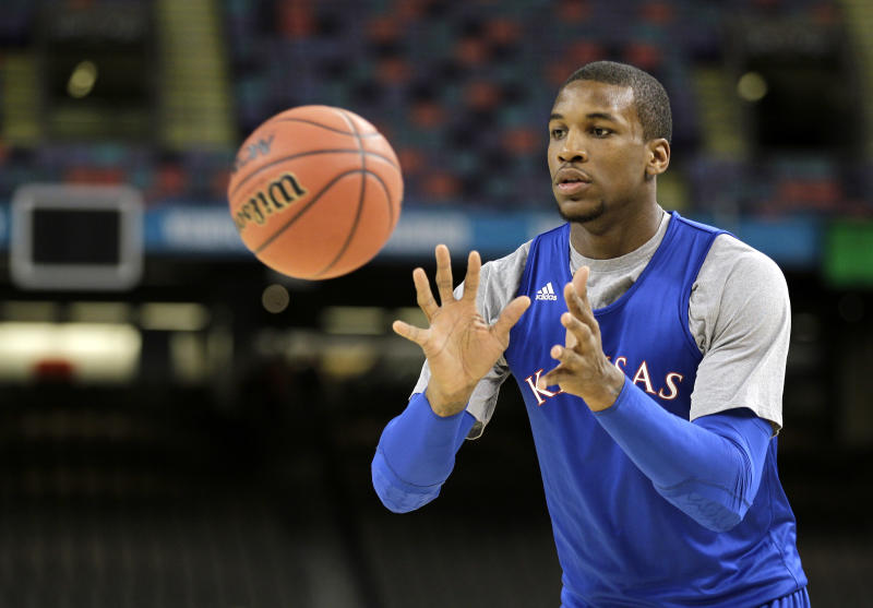 Kansas forward Thomas Robinson catches a pass during a practice session for the NCAA Final Four basketball tournament Friday, March 30, 2012, in New Orleans. Kansas plays Ohio State in a semifinal game on Saturday. (AP Photo/Mark Humphrey)
