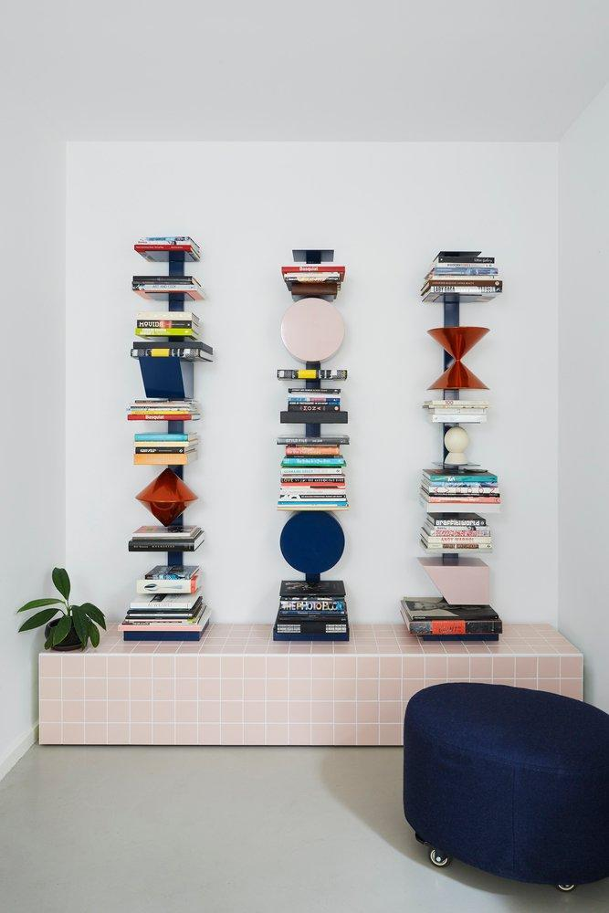 A fun, pastel pink bookshelf featured in the ultra-accessible Frenches Interiors.