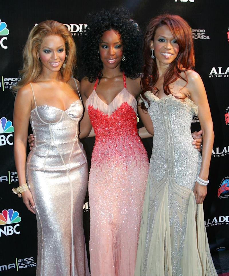 """FILE - This Oct. 25, 2004 file photo shows members of Destiny's Child, from left, Beyonce Knowles, Kelly Rowland and Michelle Williams at the Radio Music Awards at the Aladdin Theater for the Performing Arts in Las Vegas. The R&B trio announced Thursday, Jan. 10, 2013, that they will release a new track called """"Nuclear."""" The song is the group's first new offering since 2004.  (AP Photo/Eric Jamison, file)"""
