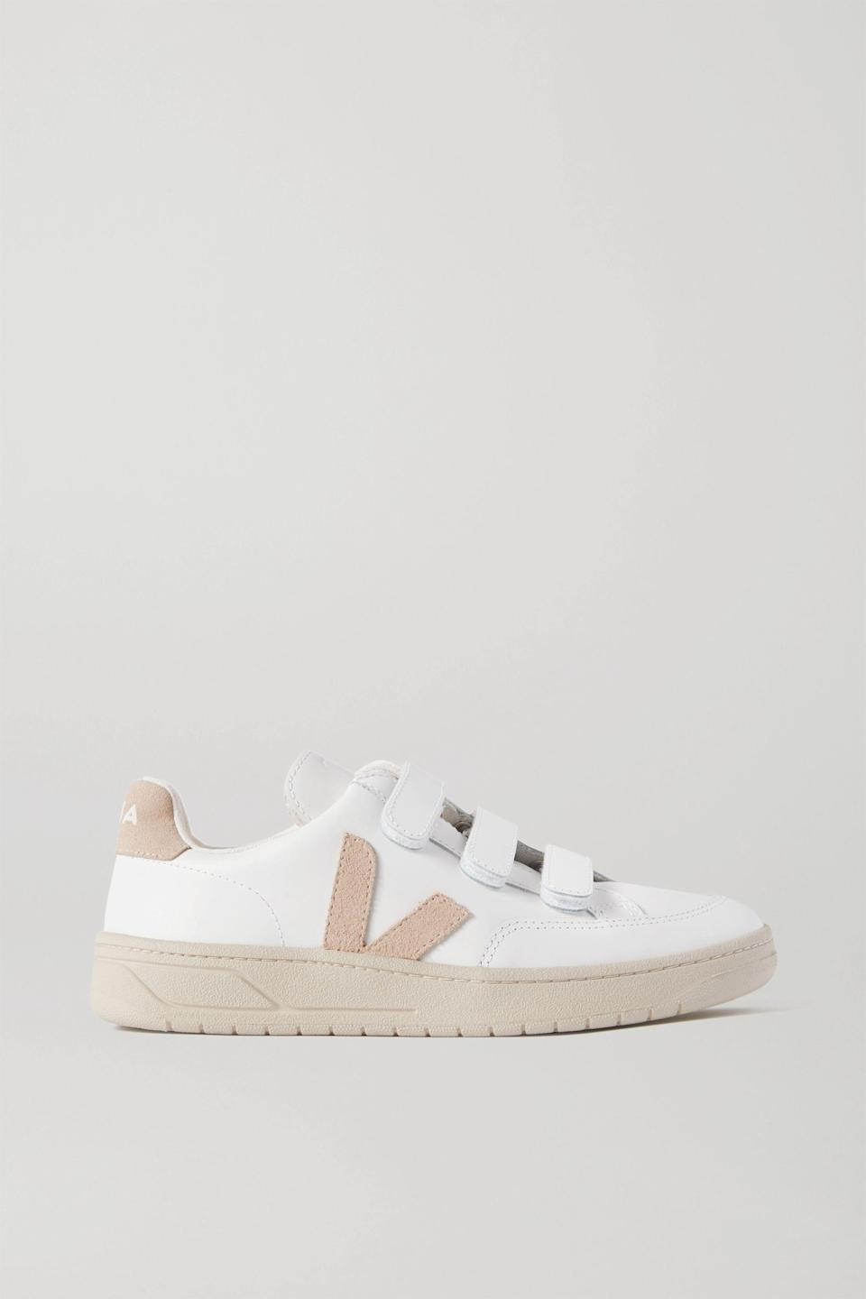 "<p><strong>Veja</strong></p><p>net-a-porter.com</p><p><strong>$84.00</strong></p><p><a href=""https://go.redirectingat.com?id=74968X1596630&url=https%3A%2F%2Fwww.net-a-porter.com%2Fen-us%2Fshop%2Fproduct%2Fveja%2Fv-lock-suede-trimmed-leather-sneakers%2F1253456&sref=https%3A%2F%2Fwww.seventeen.com%2Ffashion%2Ftrends%2Fg32826210%2Fclassic-white-sneakers%2F"" rel=""nofollow noopener"" target=""_blank"" data-ylk=""slk:Shop Now"" class=""link rapid-noclick-resp"">Shop Now</a></p><p>You're telling me these suede-trimmed leather sneakers are sustainably made <em>and</em> I don't have to tie my laces? Count me in.  </p>"