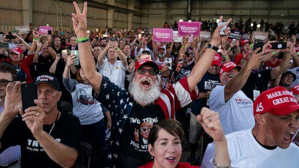 PHOTO: Supporters of President Donald Trump cheer as he arrives to speak during a campaign rally at Arnold Palmer Regional Airport, in Latrobe, Pa., Sept. 3, 2020. (Evan Vucci/AP)