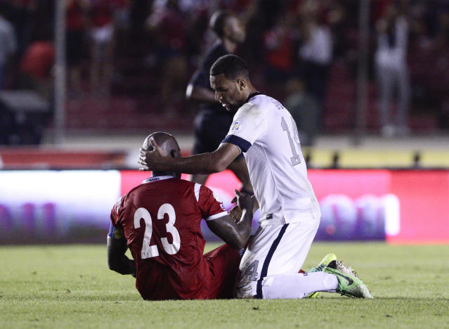 Terrence Boyd of the U.S. talks with Panama's Felipe Baloy after the U.S. defeated Panama in a 2014 World Cup qualifying soccer match in Panama City, Tuesday, Oct. 15, 2013. The United States rallied for a 3-2 win at Panama on Tuesday night that left Mexico's World Cup hopes alive and knocked out the Panamanians. (AP Photo/Arnulfo Franco)