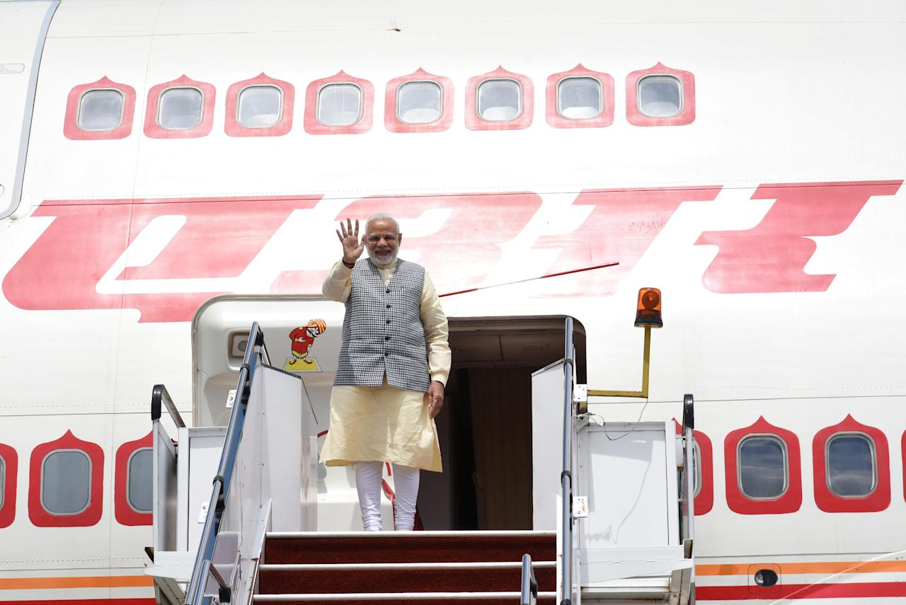 India's Prime Minister Narendra Modi waves as he boards a plane in Sepang, Malaysia May 31, 2018. Department of Information/Muhairul Azman via REUTERS ATTENTION EDITORS - THIS IMAGE WAS PROVIDED BY A THIRD PARTY. NO RESALES. NO ARCHIVES.