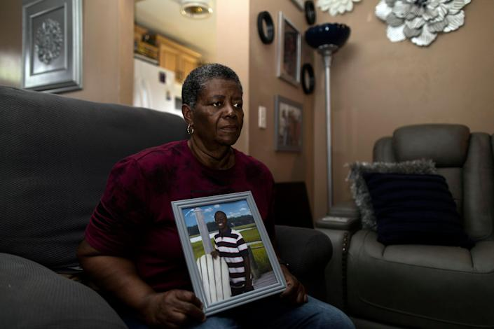 Cynthia Green, holds a photograph of her adoptive son, Sincere Pierce, at her home in Cocoa, Fla., on May 6, 2021. Pierce was 18 years old when he was shot and killed by a Brevard, Fla., deputy in Nov. 2020.