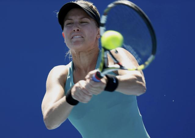 Eugenie Bouchard of Canada hits a return to Tang Haochen of China during their women's singles match at the Australian Open 2014 tennis tournament in Melbourne January 13, 2014. REUTERS/Brandon Malone (AUSTRALIA - Tags: SPORT TENNIS)