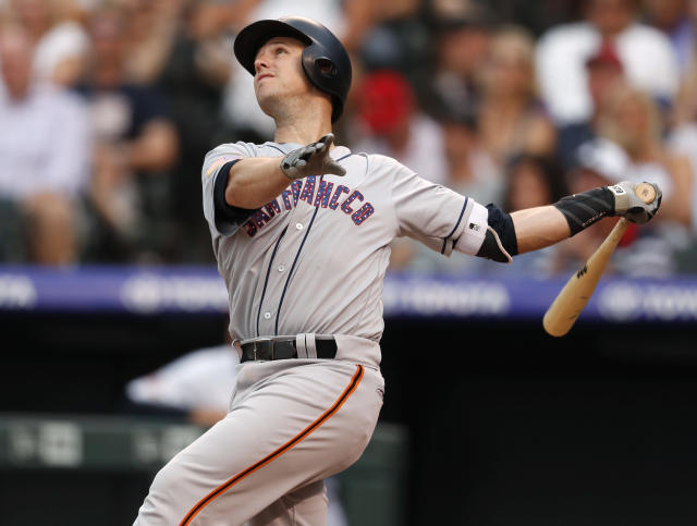 San Francisco Giants' Buster Posey flies out on a pitch from Colorado Rockies' Tyler Anderson during the fourth inning of a baseball game Wednesday, July 4, 2018, in Denver. (AP Photo/David Zalubowski)