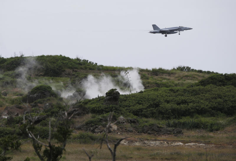 A U.S. Navy F/A-18 Super Hornet comes in for a landing during training on Iwo Jima, Japan, Friday, June 7, 2013. Iwo Jima is a training site like no other. The rugged volcanic crag is one of the most iconic battlegrounds of World War II, and is so isolated and barren it has almost never been inhabited by anyone other than military troops. But from the perspective of U.S. Navy fighter pilots who regularly train on the island's one functioning airstrip, Iwo is unique in another way. If a plane finds itself in serious trouble and for some reason that lone airstrip on the island isn't viable, the only alternative is to eject and ditch in the Pacific. It's a problem that Navy, which is now conducting training on the island to prepare pilots for deployment to the USS George Washington aircraft carrier, has been trying to fix for nearly 25 years. But, so far, Japan has failed to find a more suitable site. (AP Photo/Greg Baker)