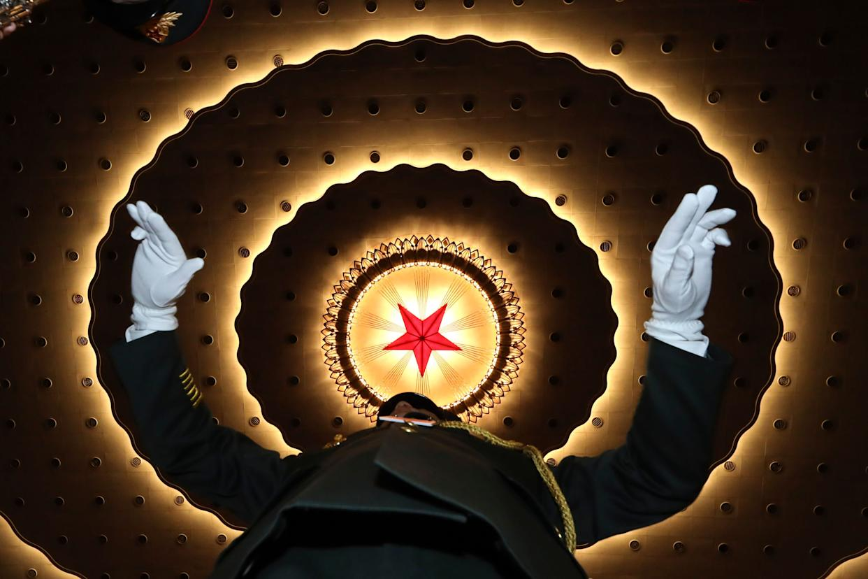 A Chinese military band conductor rehearses before the opening session of the annual National People's Congress in Beijing's Great Hall of the People, Tuesday, March 5, 2019. (AP Photo/Ng Han Guan)
