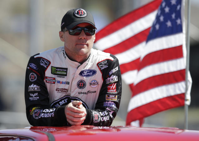 """<a class=""""link rapid-noclick-resp"""" href=""""/nascar/sprint/drivers/205/"""" data-ylk=""""slk:Kevin Harvick"""">Kevin Harvick</a> (4) stands during a parade lap before a NASCAR Cup Series auto race on Sunday, March 11, 2018, in Avondale, Ariz. (AP Photo/Rick Scuteri)"""