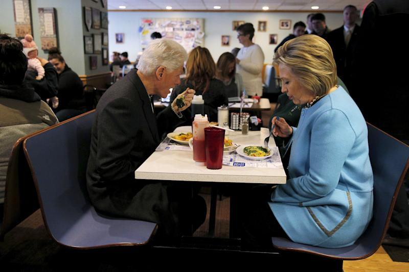 U.S. Democratic presidential candidate Hillary Clinton and her husband, former U.S. President Bill Clinton eat breakfast at the Chez Vachon restaurant in Manchester, New Hampshire February 8, 2016. REUTERS/Brian Snyder (Photo: Brian Snyder / reuters)