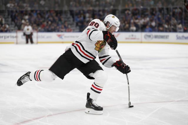 Chicago Blackhawks' Brandon Saad shoots during the first period of an NHL hockey game against the St. Louis Blues Saturday, Dec. 14, 2019, in St. Louis. (AP Photo/Jeff Roberson)