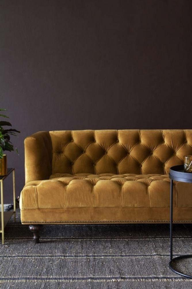"""<p>Brown may not be the obvious choice for your walls, but it does a perfect job of bringing out the richness and warmth in this fabulous gold ochre. In a darker room without much natural light, cream-coloured walls, and a natural wood flooring underfoot would achieve the same effect. </p><p>Pictured: <a href=""""https://go.redirectingat.com?id=127X1599956&url=https%3A%2F%2Fwww.rockettstgeorge.co.uk%2Ffurniture%2Fliving-room-furniture%2Fochre-gold-velvet-chesterfield-3-seater-sofa.html&sref=https%3A%2F%2Fwww.countryliving.com%2Fuk%2Fhomes-interiors%2Finteriors%2Fg37384959%2Fcolour-combinations%2F"""" rel=""""nofollow noopener"""" target=""""_blank"""" data-ylk=""""slk:Ochre Velvet Chesterfield Sofa at Rockett St George"""" class=""""link rapid-noclick-resp"""">Ochre Velvet Chesterfield Sofa at Rockett St George</a></p>"""