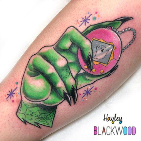 "<p>This tattoo isn't overtly about Halloween, but it has a lot of mainstays of the holiday like the witch's hand, a spiderweb, and a ghost. It's also perfectly '90s with the Tamagotchi reference. <a href=""https://www.instagram.com/hayleyblackwoodtattoo/"" rel=""nofollow noopener"" target=""_blank"" data-ylk=""slk:Hayleyblackwoodtattoo"" class=""link rapid-noclick-resp"">Hayleyblackwoodtattoo</a> knocked this one out of the park.</p><p><a href=""https://www.instagram.com/p/B9zrCprHMie/?utm_source=ig_embed&utm_campaign=loading"" rel=""nofollow noopener"" target=""_blank"" data-ylk=""slk:See the original post on Instagram"" class=""link rapid-noclick-resp"">See the original post on Instagram</a></p>"