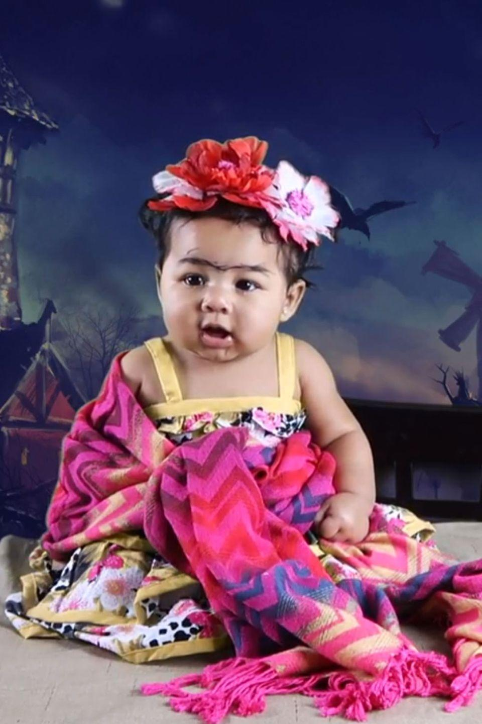 "<p>Baby unibrow <a href=""https://www.youtube.com/watch?v=cbRxvNLGsUQ&feature=youtu.be"" rel=""nofollow noopener"" target=""_blank"" data-ylk=""slk:makes this little Frida Kahlo"" class=""link rapid-noclick-resp"">makes this little Frida Kahlo</a> the most adorable artist of all time. </p><p><strong>RELATED:</strong> <a href=""https://www.goodhousekeeping.com/holidays/halloween-ideas/g23604771/babys-first-halloween-costume/"" rel=""nofollow noopener"" target=""_blank"" data-ylk=""slk:10 So-Cute-You'll-Scream Ideas for Baby's First Halloween Costume"" class=""link rapid-noclick-resp"">10 So-Cute-You'll-Scream Ideas for Baby's First Halloween Costume</a></p>"
