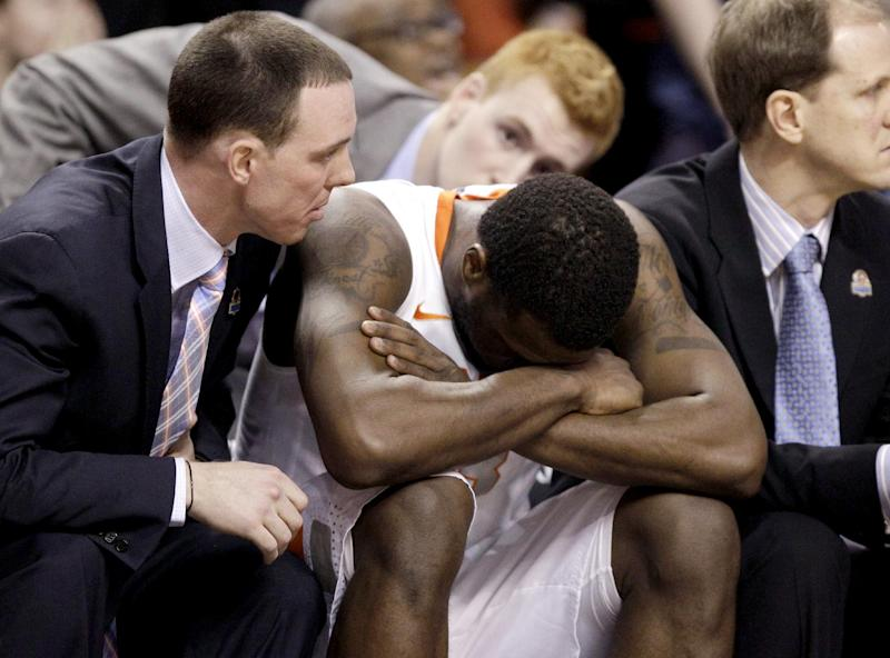 Syracuse guard Dion Waiters sits with assistant coach Gerry McNamara, left, as time winds down during the second half of the East Regional final game against Ohio State in the NCAA men's college basketball tournament, Saturday, March 24, 2012, in Boston. Ohio State won 77-70. (AP Photo/Michael Dwyer)