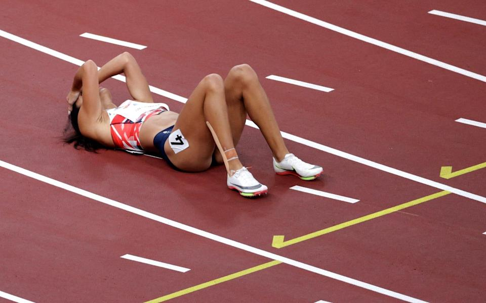 Katarina Johnson-Thompson reacts after sustaining an injury during her 200m heat - REUTERS
