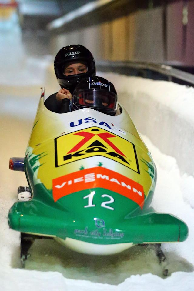 WINTERBERG, GERMANY - DECEMBER 08: Olympic champion Lolo Jones (L) and Elana Meyers of United States speed during the team competition of the FIBT Bob & Skeleton World Cup at Bobbahn Winterberg on December 8, 2012 in Winterberg, Germany. (Photo by Christof Koepsel/Bongarts/Getty Images)