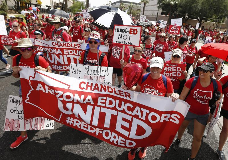 <p> Thousands march to the Arizona Capitol for higher teacher pay and school funding Thursday, April 26, 2018, in Phoenix. (AP Photo/Ross D. Franklin) </p>